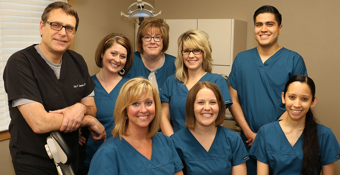 John James, DDS with Klondike Dental Care staff